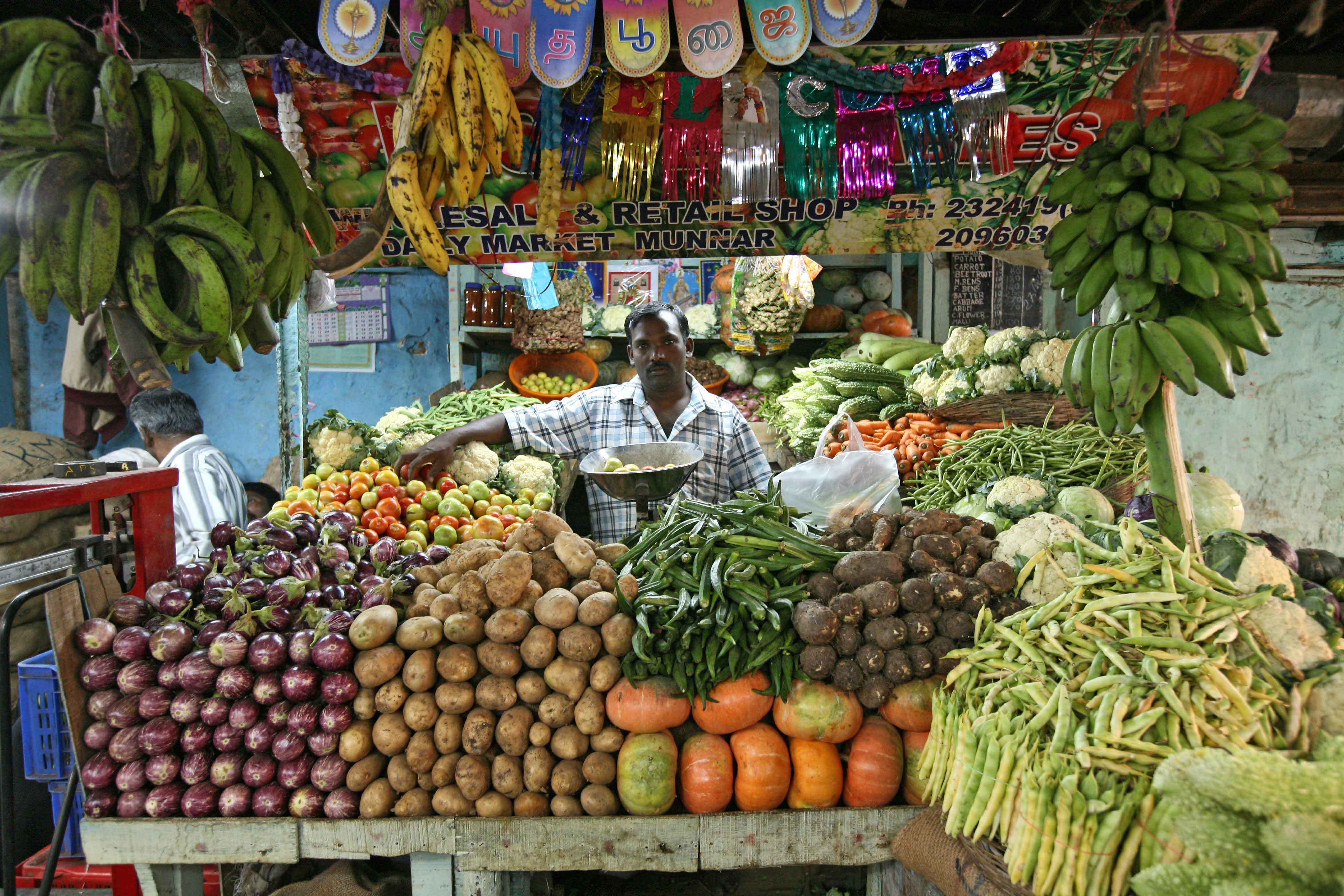продавец овощей и фруктов в Керале